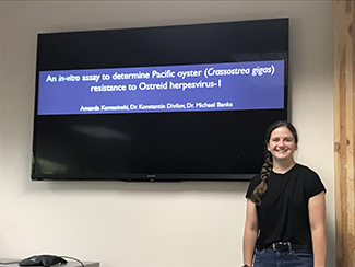REU Student Amanda Komasinski following her presentation on Pacific oyster resistance to Ostreid herpesvirus-I.
